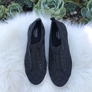 Coach black slip on sneakers